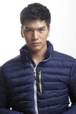 Portrait of Asian man in the down coat. Photo of Portrait of Asian man in the down coat Stock Photography