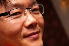 Portrait of Asian Man in Glasses Stock Photo