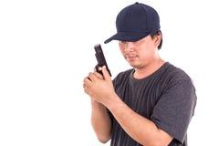 Portrait of Asian man holding gun isolated on white Royalty Free Stock Photos