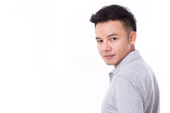 Portrait of asian man looking over his shoulder. White isolated background Stock Photography