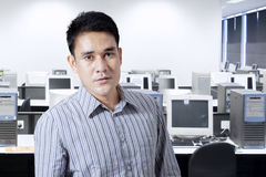 Portrait of asian man in office Royalty Free Stock Photos