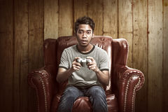 Portrait of asian man playing video games Royalty Free Stock Images