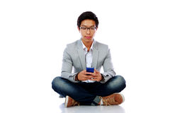 Portrait of asian man sitting on the floor Stock Photography