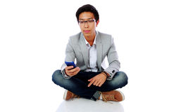 Portrait of asian man sitting on the floor Royalty Free Stock Image