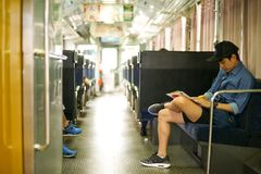 Portrait Asian man sitting on the seat in the train during travelling royalty free stock photography
