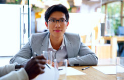 Portrait of asian man sitting at the table Royalty Free Stock Photos