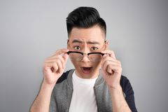 A portrait of asian man with surprised emotion face Stock Photography