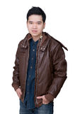 Portrait of asian man wearing jeans shirt amd jacket. Portrait of asian man wearing jeans shirt and leather jacket, close up shot on white background Stock Photography