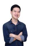 Portrait of asian man wearing jeans shirt. Portrait of asian man crossed arms and weared jeans shirt, close up shot on white background Royalty Free Stock Photos