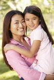 Portrait Asian mother and daughter outdoors Royalty Free Stock Photo