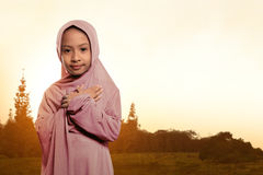 Portrait of asian muslim child wearing veil standing Stock Images