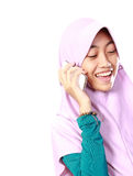 Portrait of an asian muslim kid talking on the cell phone Stock Photography