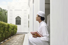 Portrait of asian muslim man holding quran Royalty Free Stock Photography