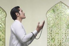 Portrait of asian muslim man praying to god Royalty Free Stock Images