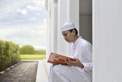 Portrait of asian muslim man reading the Koran Stock Photography
