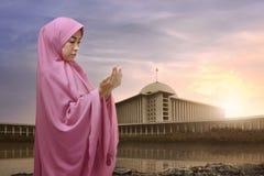 Portrait of asian muslim woman in hijab praying Stock Photo
