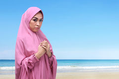 Portrait of asian muslim woman with hijab praying to god Stock Photos