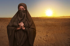 Portrait of asian muslim woman in niqab clothes praying Stock Photos