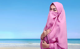Portrait of asian muslim woman with niqab holding prayer beads Stock Images