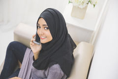 Portrait of a asian muslim woman talking on the cell phone Royalty Free Stock Photos