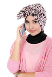 Portrait of a asian muslim woman talking on the cell phone Stock Images