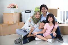 Parent and kids with cardboard box. moving to new house. Portrait of asian parent and kids with cardboard box. moving to new house concept Royalty Free Stock Images