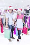 Asian family buying Christmas gifts in the store Royalty Free Stock Photography