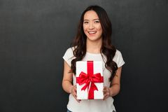Portrait of asian satisfied woman in casual t-shirt smiling and Stock Images