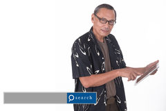 Portrait of asian senior man using smart device with search engi. Ne graphics Stock Images