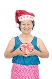 Portrait of asian senior woman holding gift box Stock Image