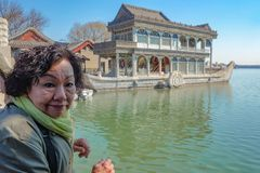 Portrait Of asian senior women with Marble Stone Boat in Summer palace Beijing. Portrait Of asian senior woman with Marble Stone Boat in Summer palace Beijing royalty free stock image