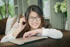 Portrait of Asian sexy business woman with a laptop.  Royalty Free Stock Photos