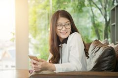 Portrait of Asian sexy business woman with a laptop Royalty Free Stock Image