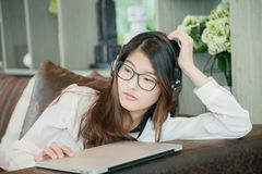 Portrait of Asian sexy business woman with a laptop Stock Photo