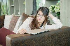 Portrait of Asian sexy business woman with a laptop.  Royalty Free Stock Image