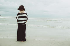 Portrait asian single tattoo hipster indy women lonely at beach. Portrait asian single tattoo hipster indy woman lonely stand alone on the beach vintage mute royalty free stock images