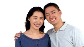 Portrait of Asian smiling couple posing stock footage