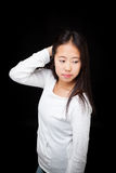 Portrait of Asian Teen Girl Posing on Black Background Royalty Free Stock Image