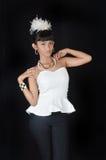 Portrait of asian teenage girl. Dressing glamorous white and black on black background Royalty Free Stock Images