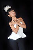 Portrait of asian teenage girl. Dressing glamorous white and black on black background Royalty Free Stock Photography