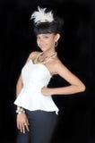 Portrait of asian teenage girl. Dressing glamorous white and black on black background Stock Photography