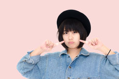 Portrait of Asian teenager girl isolated on pink Royalty Free Stock Image