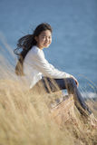 Portrait of asian teenager relaxing on natural field Royalty Free Stock Photography