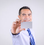 Portrait of asian Thai business man smile and showing blank whit Stock Photography