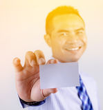 Portrait of asian Thai business man smile and showing blank whit Royalty Free Stock Photo