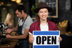 Portrait of a asian waiter showing open sign Royalty Free Stock Photos