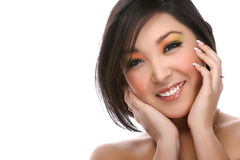 Portrait of asian woman. Attractive young woman isolated on white and smiling to the camera Royalty Free Stock Photo