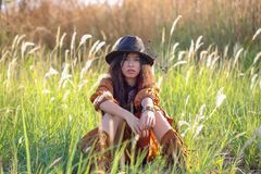 Woman with bohemian style. Portrait of asian woman with bohemian style in the field stock photos