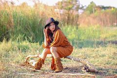Woman with bohemian style. Portrait of asian woman with bohemian style in the field royalty free stock photography