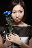 Portrait of asian woman with bouquet Royalty Free Stock Photos